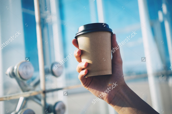 Mockup of Coffee Cup Holding in Hand